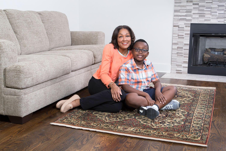 family enjoying clean area rug