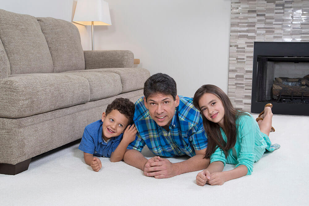 family playing on protected clean carpet