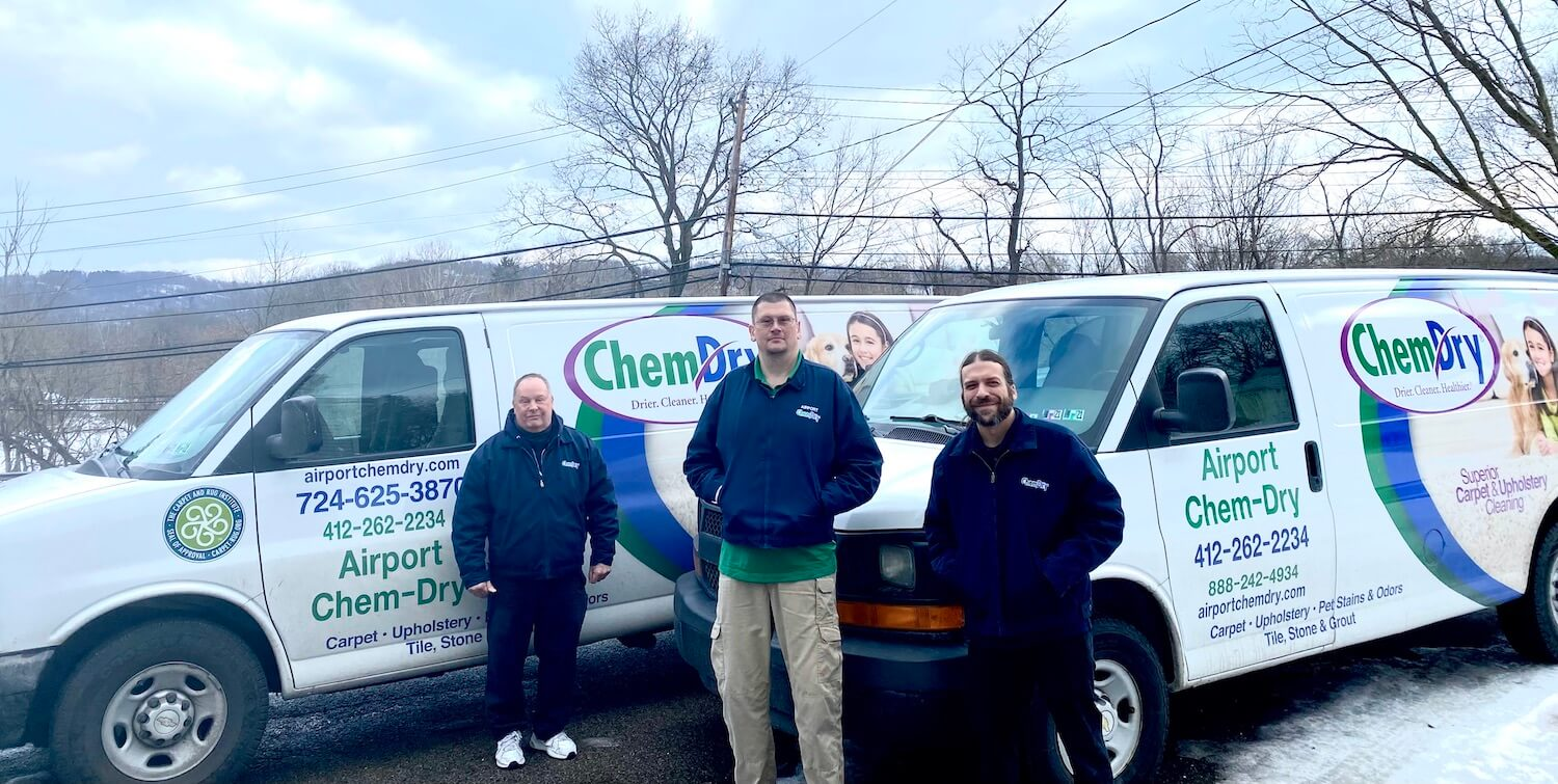 Airport Chem-Dry service van and technician preparing for carpet cleaning service